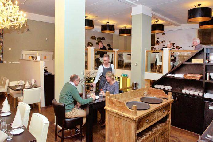 Klein Hartenstein is een erg mooi restaurant, met slim ingerichte hoeken waar je beschut kunt zitten.