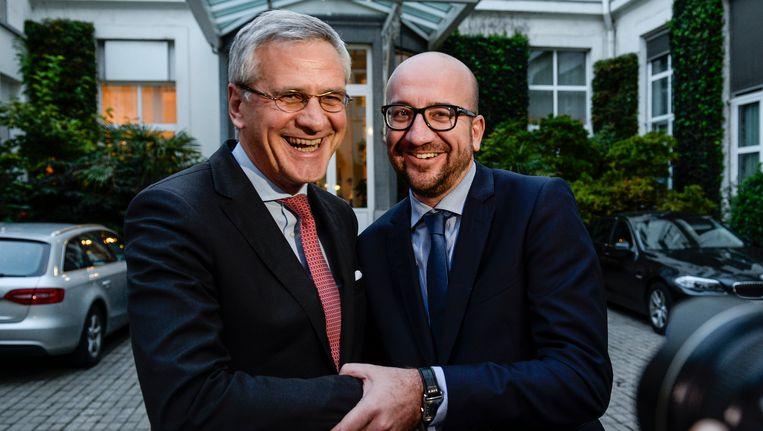 Co-formateurs Kris Peeters en Charles Michel na de deal over een regeerakkoord en de begroting Beeld BELGA