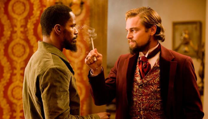 Jamie Foxx als Django met Leonardo DiCaprio als Calvin Candle .