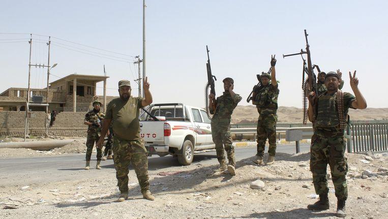 Iraakse militairen en Sjiitische milities in Amerli, gisteren. Beeld reuters