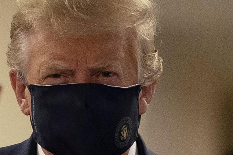 'Ik wil het nog steeds bagatelliseren, omdat ik geen paniek wilde veroorzaken', aldus Trump. Beeld Reuters