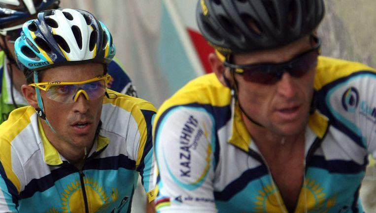 Cantador (links) koos tijdens de slotklim van de zevende etappe de aanval, terwijl dat volgens ploeggenoot Lance Armstrong (rechts) niet afgesproken was. Foto EPA Beeld
