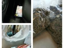 Politie vindt stapels geld in geheime lade en drugs bij fouilleeractie