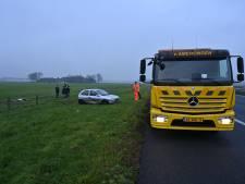 Forse file op A50 na ongeval waarbij auto in sloot belandt
