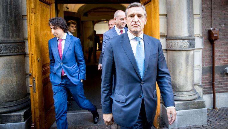 10 oktober: chagrijnige gezichten bij de fractieleiders van de oppositie na overleg met Rutte. De sfeer daalt naar een dieptepunt. Beeld anp