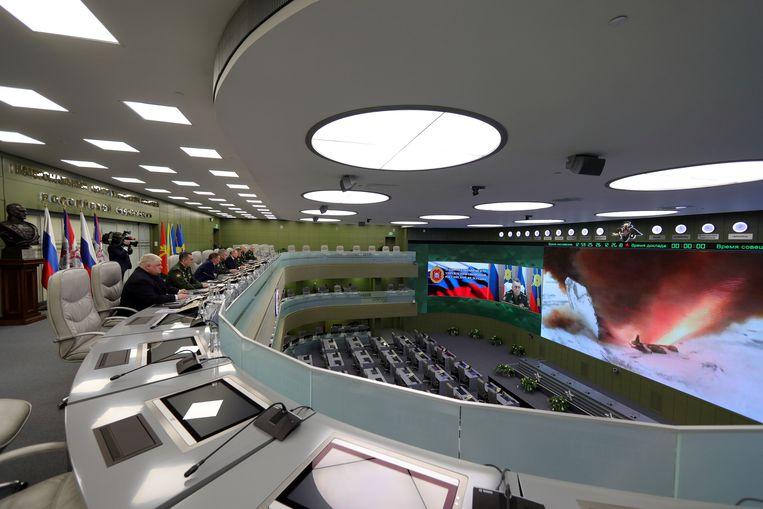 President Poetin bezoekt het  Nationale Defensiecontrolecentrum in Moskou voor een test van de nieuwe  'Avangard'-raket, 26 december 2018.  Beeld REUTERS