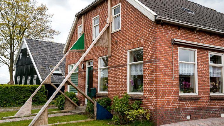 Een beschadigde woning in Loppersum. Beeld anp