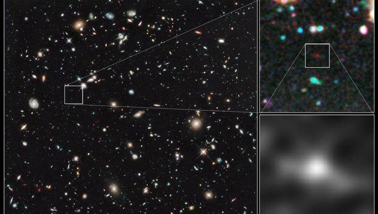 Het uitvergrote stipje op deze Hubble-foto is mogelijk het verst verwijderde sterrenstelsel dat ooit is waargenomen. Foto:NASA/ESA/R. Bouwens Beeld