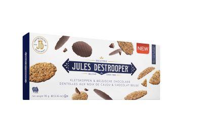Jules Destrooper giet laagje chocolade over zijn Kletskoppen