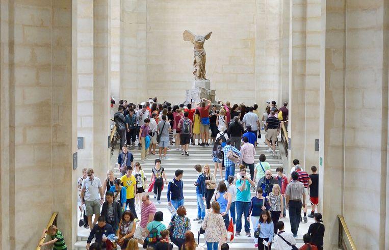 Het Louvre met de Nikè van Samothrake. Beeld Getty Yaw-Ming Tsai