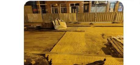Deze nachtbraker helpt stratenmakers ongevraagd een handje