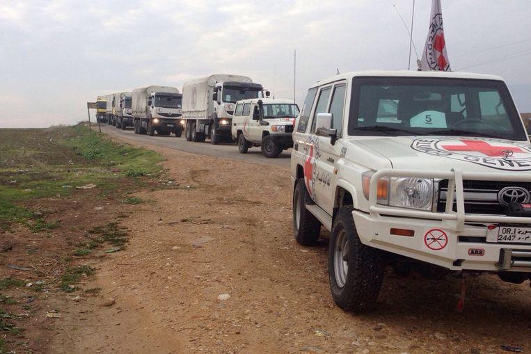 Hulptroepen van het Rode Kruis.  Beeld EPA