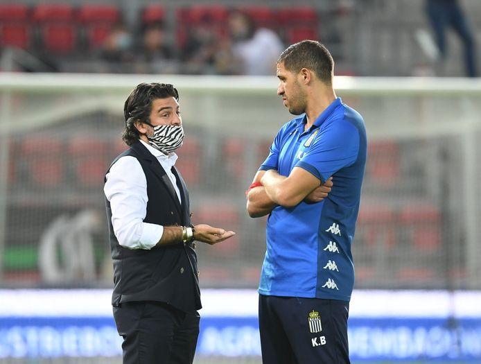 Met z'n coach Karim Belhocine.