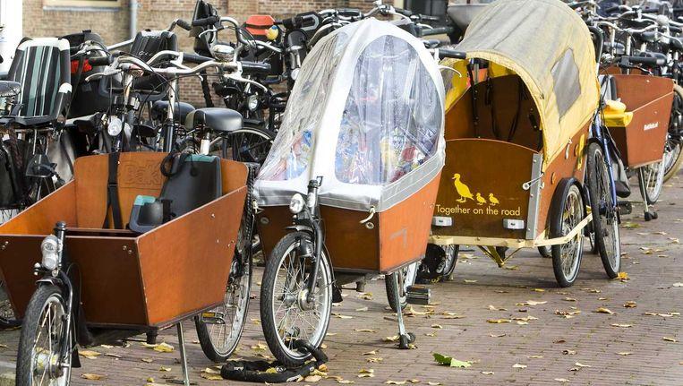 Bakfietsen in Amsterdam. Beeld anp