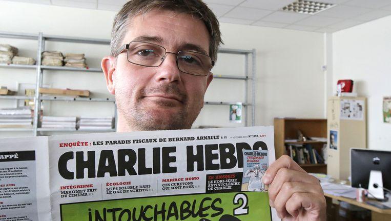 Stephane Charbonnie, voormalig hoofdredacteur van Charlie Hebdo, in 2012. Charbonnie werd tijdens de aanslag op het satirische weekblad doodgeschoten. Beeld AP