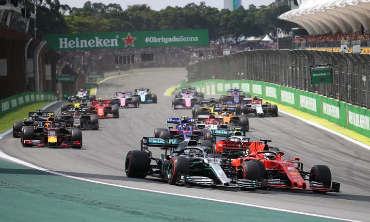 Formula One F1 - Brazilian Grand Prix - Autodromo Jose Carlos Pace, Interlagos, Sao Paulo, Brazil - November 17, 2019  Ferrari's Sebastian Vettel and Mercedes' Lewis Hamilton in action at the start of the race  REUTERS/Ricardo Moraes