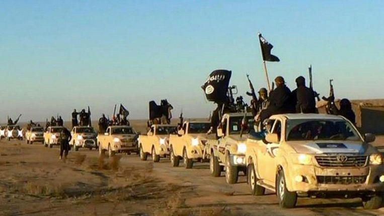 Strijders van Islamitische Staat in Raqqa, de hoofdstad van het kalifaat. Beeld null
