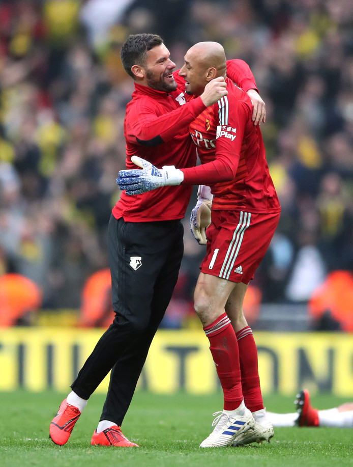 Watford goalkeepers Ben Foster (left) and Heurelho Gomes celebrate victory after the FA Cup semi final match at Wembley Stadium, London.