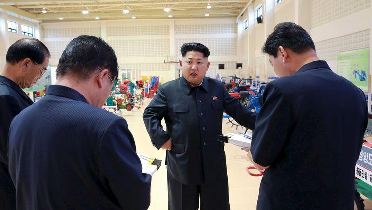 Voice of the Martyrs Korea gelooft dat de Bijbel de basis kan vormen voor verzet tegen het regime van Kim Jong-un (hier midden op de foto). Beeld afp