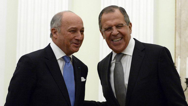 De Franse minister van buitenlandse zaken Laurent Fabius was gisteren in Moskou op bezoek bij zijn Russische collega Sergej Lavrov. Beeld ap