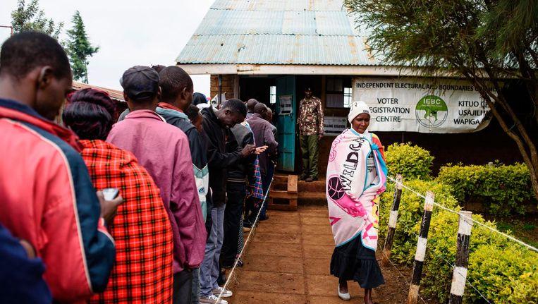 Lange rijen voor stemlokalen in Kenia. Beeld afp