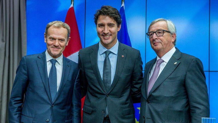 EU-president Donald Tusk, de Canadese premier Justin Trudeau en Europees Commissievoorzitter Jean-Claude Juncker ondertekenden CETA. Beeld anp