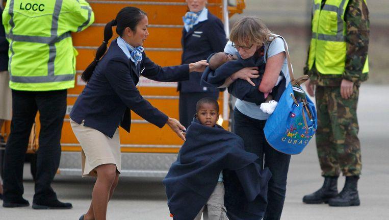 Na de aardbeving in 2010 werden 106 kinderen uit Haïti in Nederland opgevangen door Nederlandse adoptieouders Beeld anp