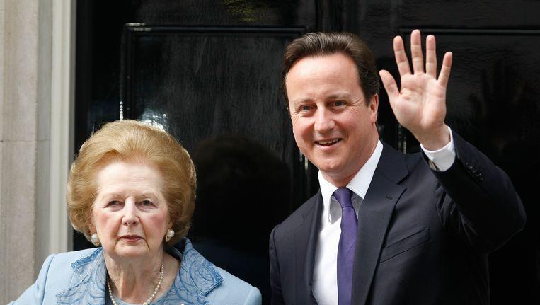 Thatcher in 2010 met de huidige Britse premier Cameron. Beeld AP
