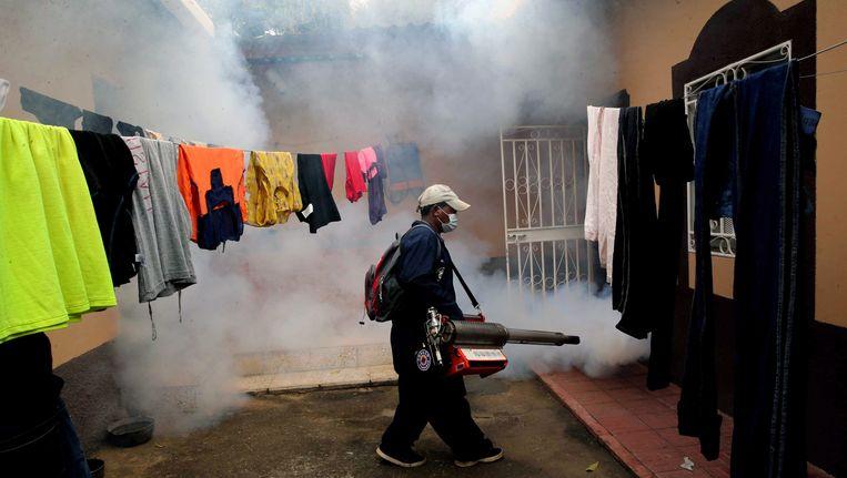 In Honduras wordt in wijken alles gedaan om de Zika-mug uit te roeien. Beeld EPA