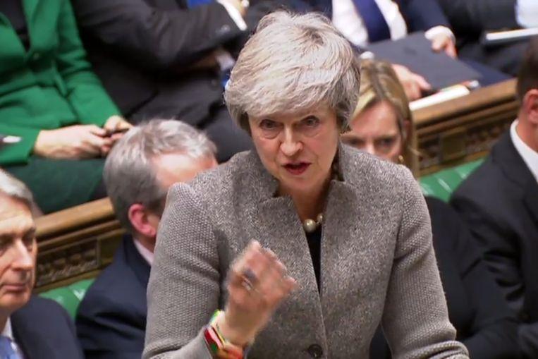 Premier Theresa May geeft antwoord op vragen na haar verklaring in het Britse Lagerhuis. Beeld AFP