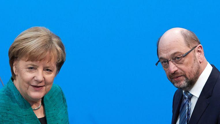 Angela Merkel en Martin Schulz na de persconferentie over hun bereikte regeerakkoord. Beeld null