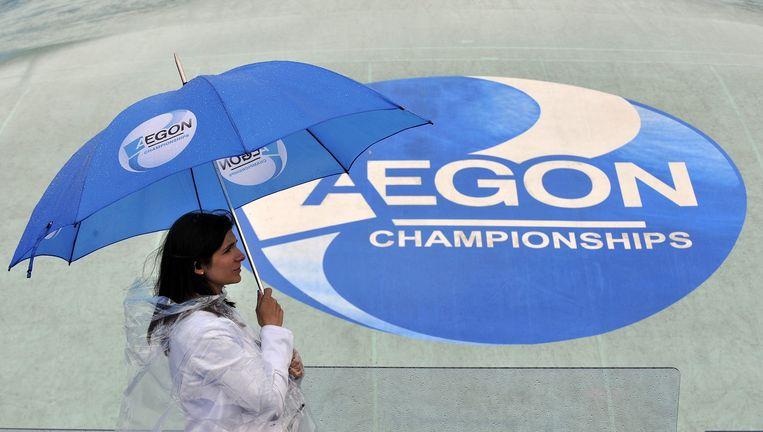 Een regenachtige dag tijdens het internationale tennistoernooi van Queen's in Londen. Aegon is sponsor van het toernooi. Beeld epa