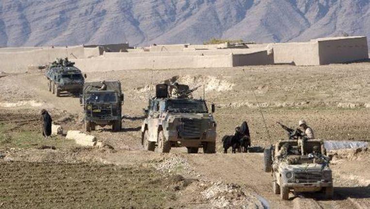 Een Nederlandse ISAF TF-U patrouille in de omgeving van Deh Rawod in Aghanistan, 22 december 2006. (Foto ANP, AudioVisuele Dienst Defensie) Beeld