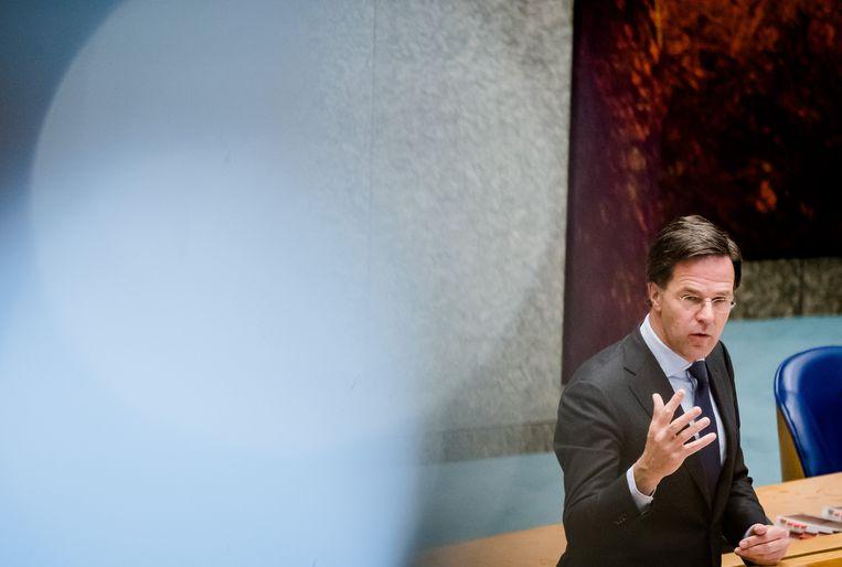 Premier Mark Rutte tijdens het debat in de Tweede Kamer over de ontwikkelingen rondom het coronavirus.  Beeld ANP