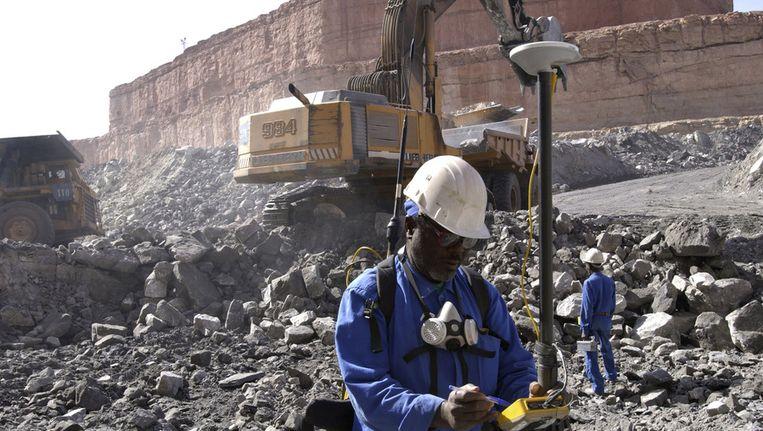 Mijnwerkers bij de uraniummijn Beeld ap