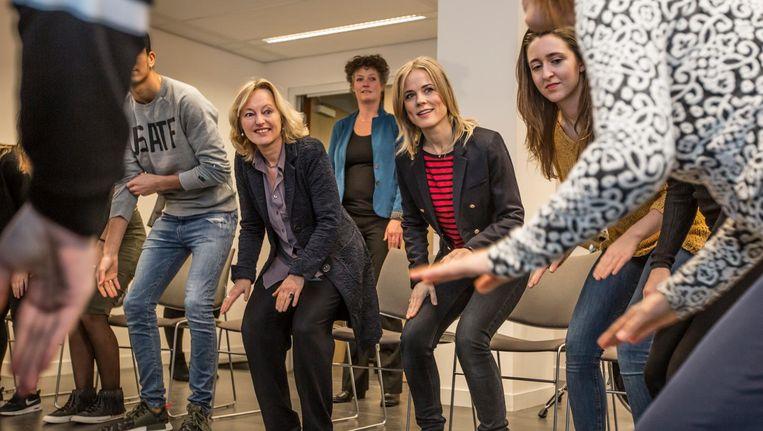Minister Bussemaker en Ilse DeLange gaven gisteren het goede voorbeeld op de HvA Beeld Eva Plevier