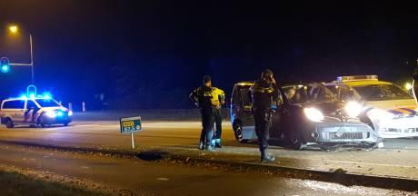 Politiewagen botst met busje op Utrechtseweg