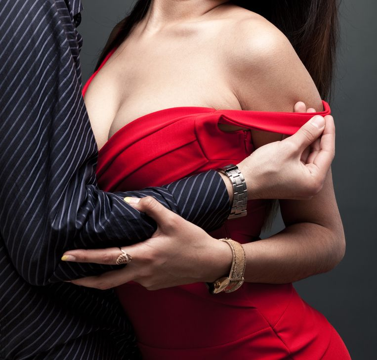 man grabbing her dress