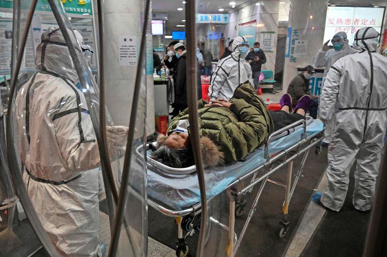 De coronaziekte brak uit in het Chinese Wuhan. Beeld AFP