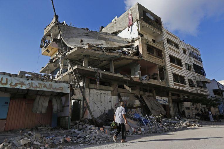 Een verwoest appartementenblok. Beeld ap