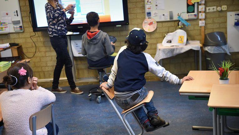 Een basisschoolklas. De kinderen op deze foto zijn niet gerelateerd aan Kubo. Beeld Marcel van den Bergh / de Volkskrant