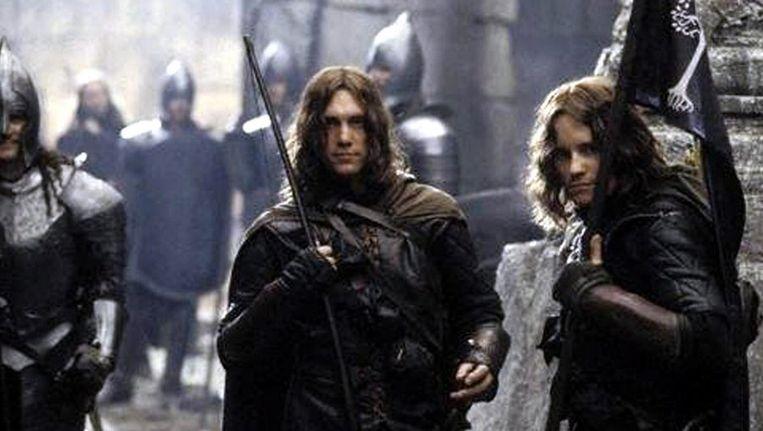 Een scene uit de film Lord of the Rings, met in het midden de kleinzoon van de schrijver Tolkien, die een kleine rol had. Beeld