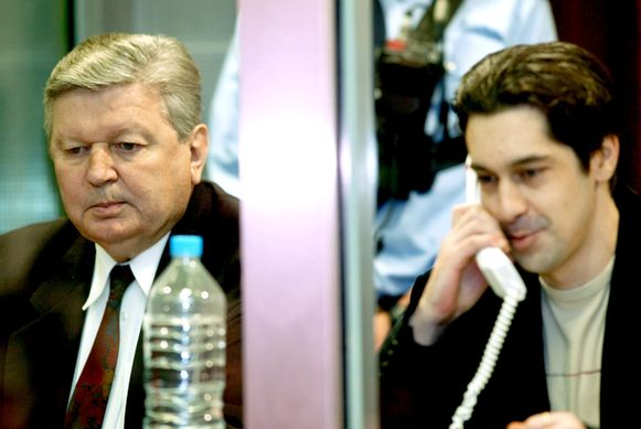 Michel Nihoul en Michel Lelievre tijdens het proces Dutroux in  2004