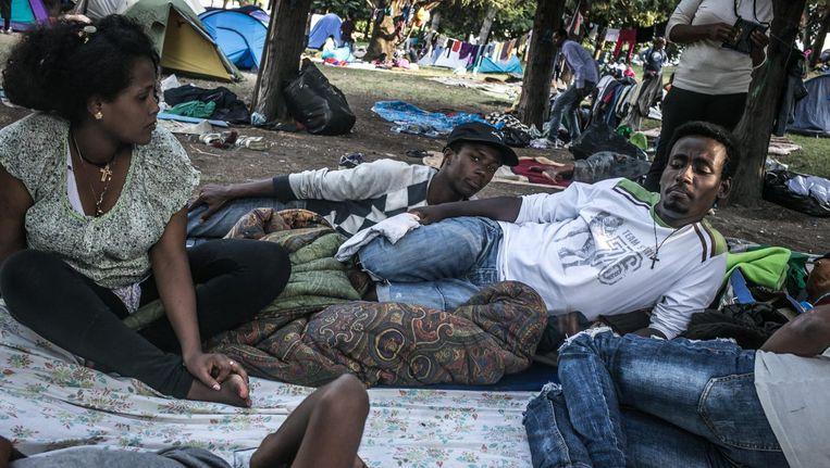 Vluchtelingen bij het Comomeer. Beeld Nicola Zolin