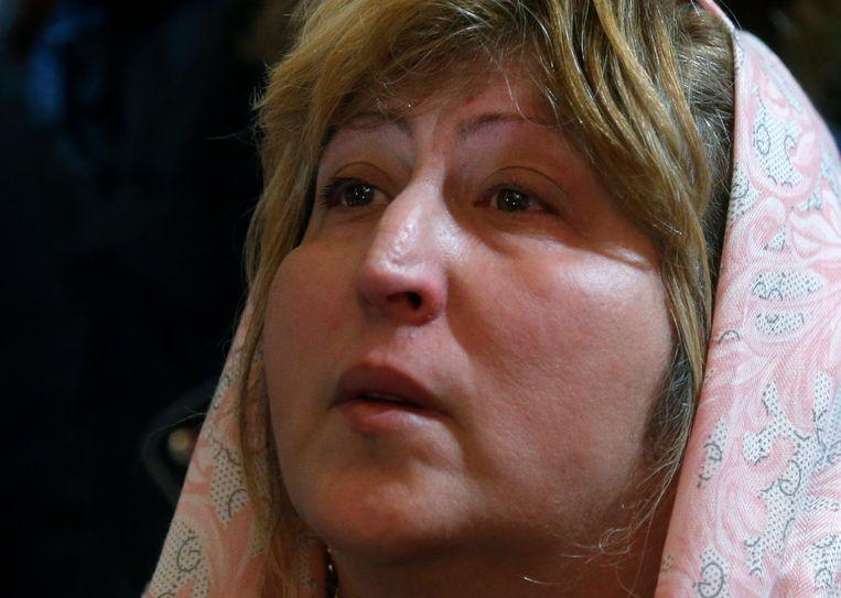 Een biddende vrouw in de Christus Verlosserskathedraal. Beeld Sergei Chirikov / EPA